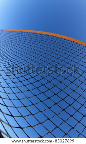 beach volleyball net in blue sky - stock photo