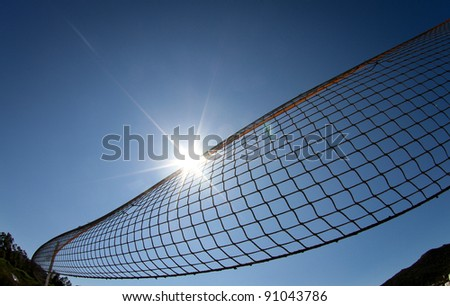 beach volleyball net in sunny sky - stock photo