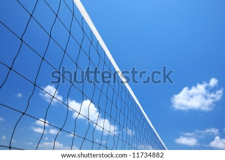 beach volleyball net on a blue sky - stock photo
