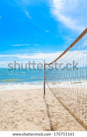 beach volleyball net on the beach with blue sky - stock photo