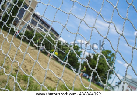 Beach volleyball players through the net. Rio games. - stock photo