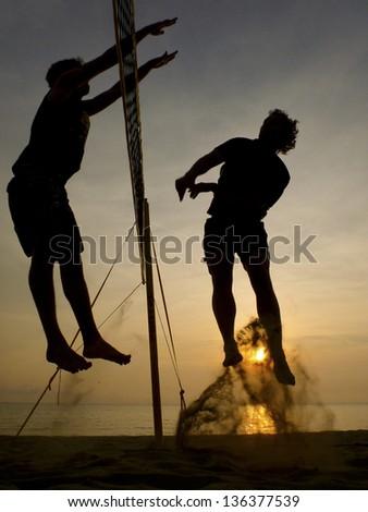 beach volleyball - silhouette - stock photo