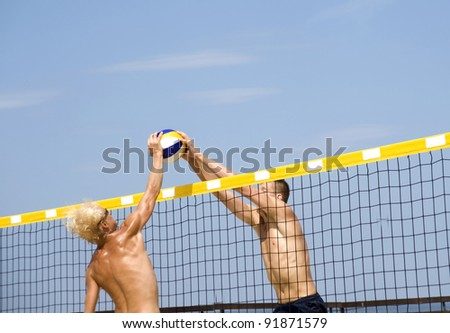 Beach volleyball. The blow block over a grid. - stock photo