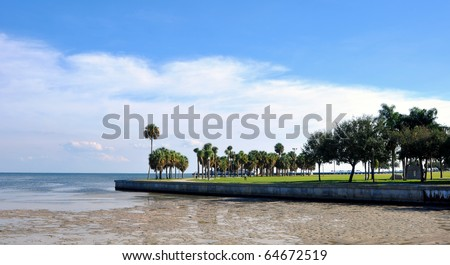 Beach walkway with a low-tide ocean in St. Pete, Florida - stock photo