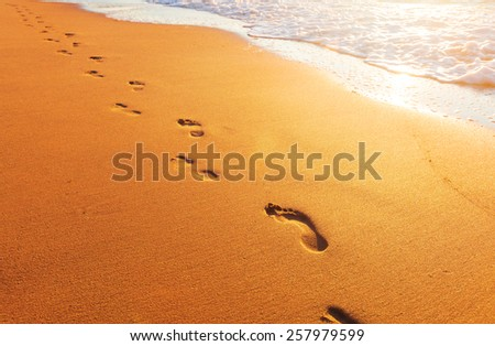 beach, wave and footprints - stock photo