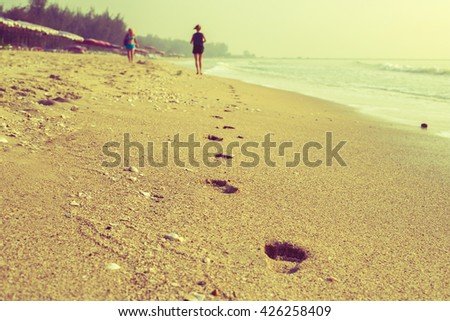 beach, wave and footsteps - stock photo
