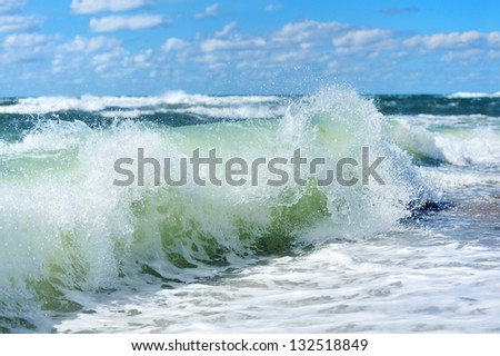 Beach Wave, view in the tube with beach in background - stock photo
