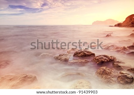 beach waves water in bright color tones - stock photo