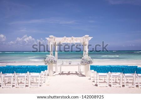 Beach Wedding Ceremony with Blue Water - stock photo