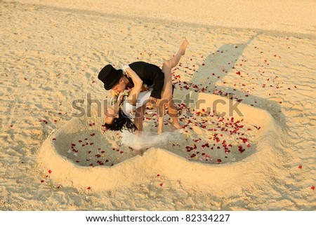 Beach wedding of happy newlywed couple - stock photo