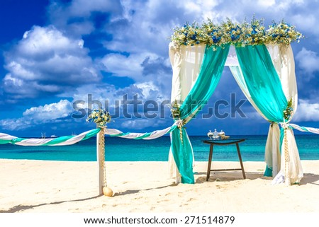 beach wedding venue, wedding setup, cabana, arch, gazebo decorated with flowers - stock photo