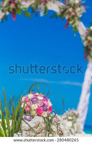 beach wedding venue, wedding setup, cabana, arch, gazebo decorated with flowers, beach wedding setup - stock photo