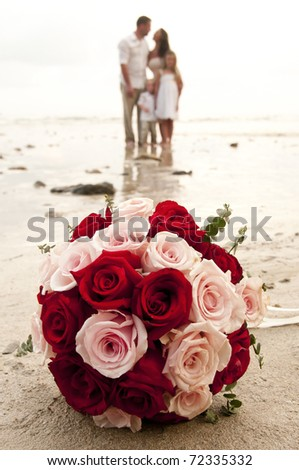 beach wedding with children of bride and groom on beach in Thailand
