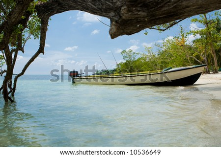 Beach with a boat ashore - stock photo