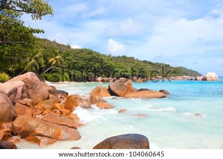 Beach with boulders on the Praslin island - stock photo