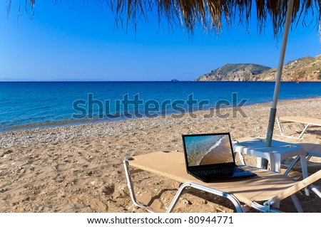 Beach with laptop - stock photo