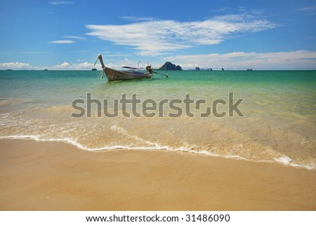 beach with longboat - stock photo
