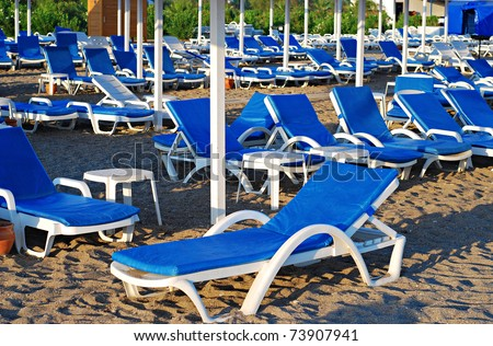 Beach with lot of chair without people. Travel background.