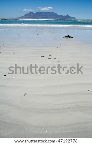 Beach with mountain the background - stock photo