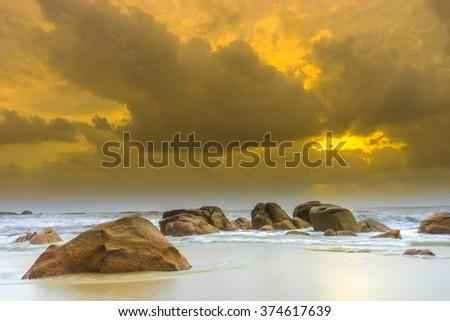 Beach with orange cloudy - stock photo