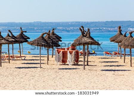 beach with parasol - stock photo