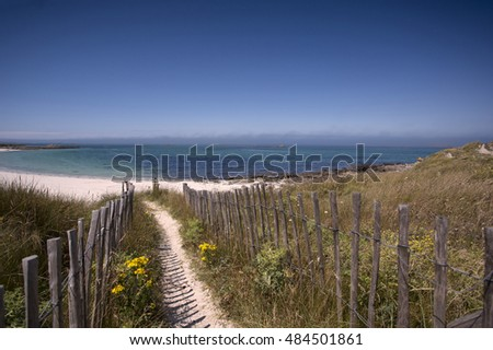 Beach with Path and Fence in Brittany France on a sunny day in summer