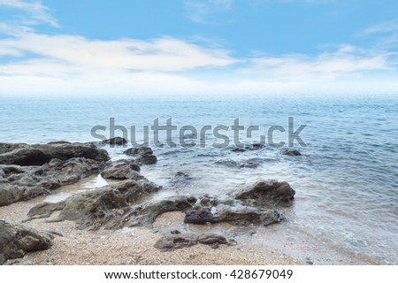 Beach with rocks and a sky.