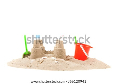 Beach with sand, fishing net and toys isolated over white background - stock photo