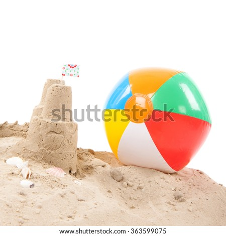 Beach with sandcastle and toys isolated over white background - stock photo