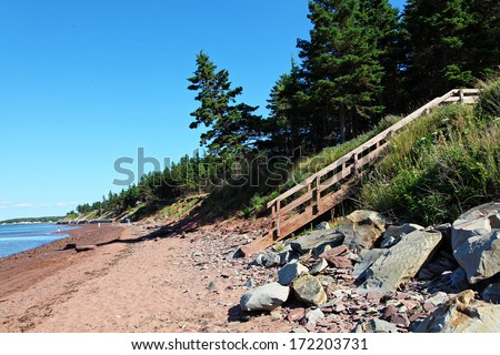 Beach with stairs and rocks in Nova scotia - stock photo