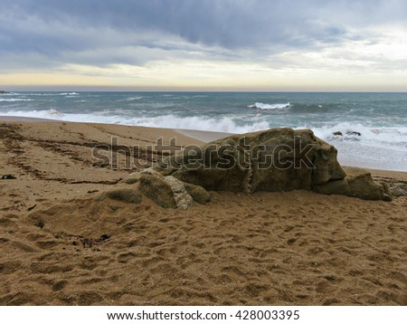 Beach with stormy weather - stock photo