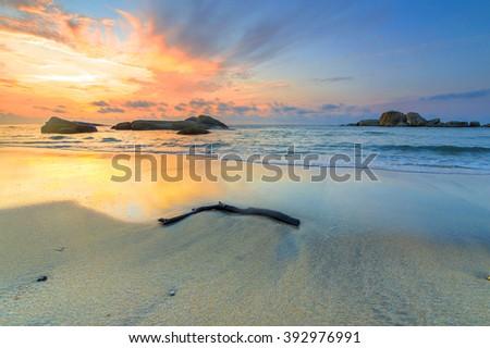 Beach with sunrise background - stock photo