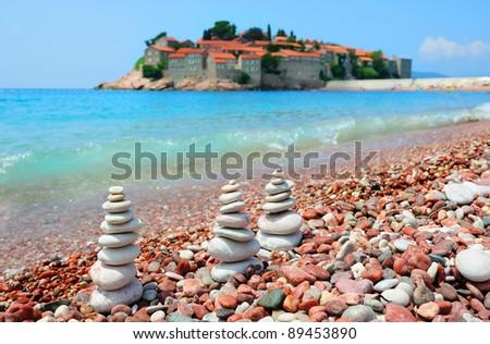 Beach with three rock pyramids in Montenegro - stock photo