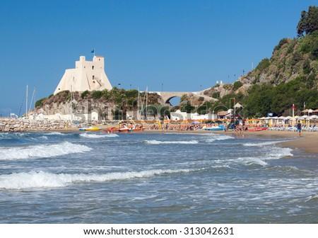 Beach with Truglia Tower in Sperlonga, Italy. - stock photo