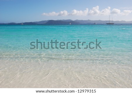 Beach with turquoise waters.  British Virgin Islands.