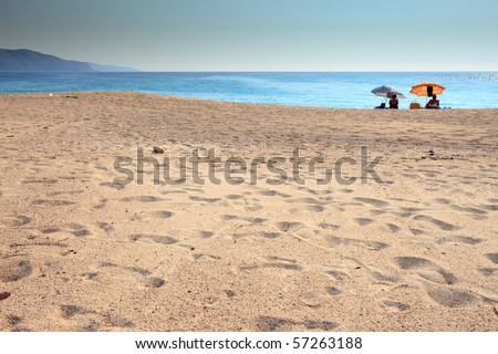 Beach with two umbrellas, Corsica, France - stock photo