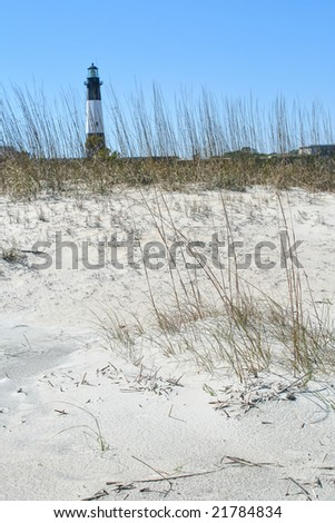 Beach with Tybee island  lighthouse in background. - stock photo