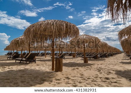 Beach with umbrellas in summer - stock photo