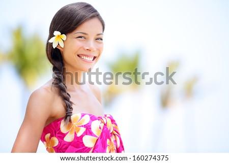 Beach woman smiling happy in sarong - in joyful bliss on travel vacation. Pretty mixed race Asian Caucasian woman on Hawaiian beach resort. Hawaii, USA. - stock photo