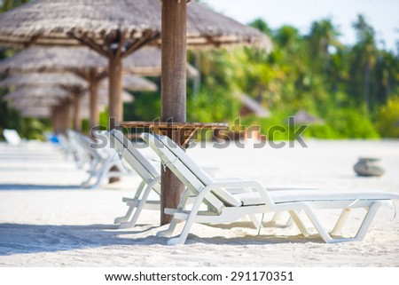 Beach wooden chairs for vacations on tropical beach - stock photo
