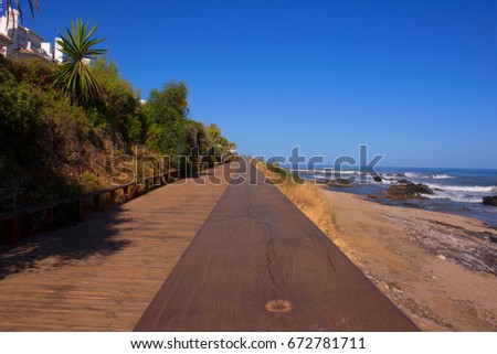 Beach. Wooden road in the beach. Costa del Sol, Andalusia, Spain.