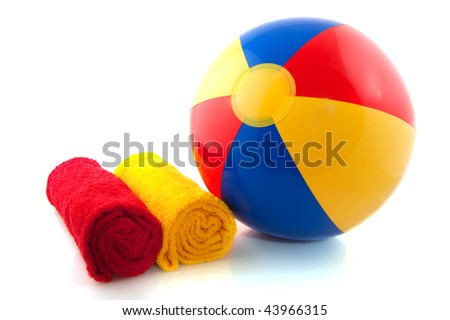 beachball and rolled towels for the summer vacation - stock photo