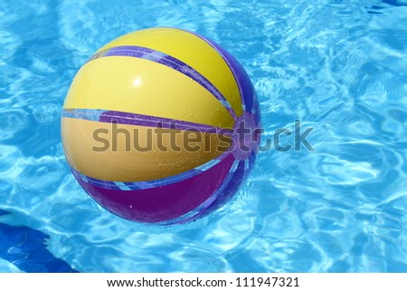 Beachball and swimmingpool. vacations background