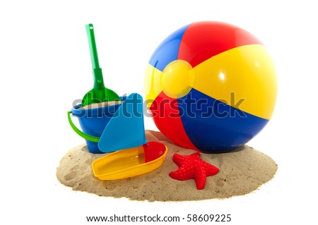 Beachball with sand and bucket for the beach - stock photo