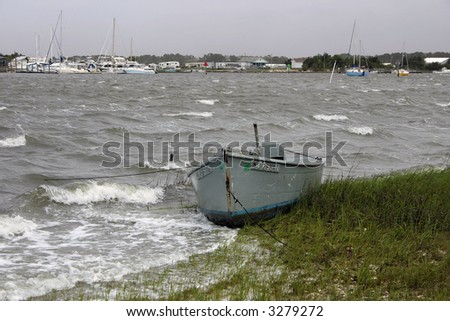beached boat during tropical storm
