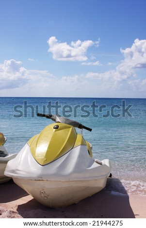 Beached Jet Ski on shore of tropical  getaway - stock photo