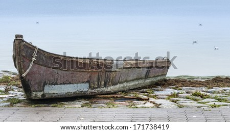 Beached old fishing boat