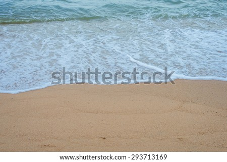 Beaches and sea, Sea waves lapped the sandy beach.