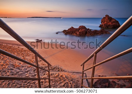 Beaches of the French Riviera: staircase descending on the beach at sunrise - Cannes