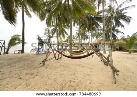 beachside hammock tied to a tree with relaxing holiday on the white sand tropical beach and beachside stock images royalty free images  u0026 vectors   shutterstock  rh   shutterstock